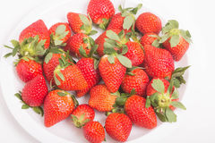 Fresh Strawberries on White Plate Royalty Free Stock Photos