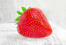Fresh strawberries on white wooden table. Hi res Stock Photography