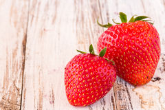 Fresh strawberries on white wooden table Stock Photography