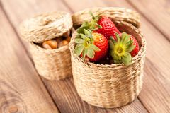 Fresh strawberries in a wicker basket Stock Images