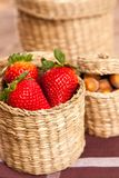 Fresh strawberries in a wicker basket Royalty Free Stock Image