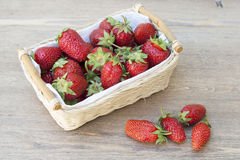 Fresh strawberries. In a wicker basket stock photography