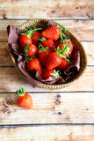 Fresh strawberries in a wicker basket Stock Photography