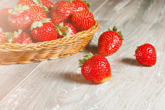 Fresh strawberries on wood background Stock Photo
