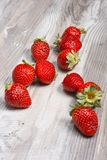 Fresh strawberries on wood background Royalty Free Stock Photos