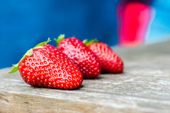 Fresh strawberries on a wood background Royalty Free Stock Photos