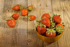 Fresh strawberries in wood bowl Stock Photo