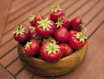 Fresh strawberries in wood bowl Royalty Free Stock Photo