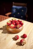 Fresh strawberries in wood bowl Stock Photo