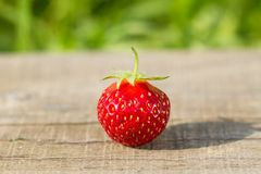 Fresh strawberries on wooden background, close up Royalty Free Stock Image
