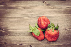 Fresh strawberries on wooden background. Fresh strawberries on old wooden background with copy space Royalty Free Stock Image