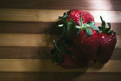 Fresh strawberries on a wooden background. Still life Royalty Free Stock Image