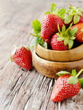 Fresh strawberries in a wooden bowl, selective focus Royalty Free Stock Photos