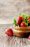 Fresh strawberries in a wooden bowl, selective focus Royalty Free Stock Images