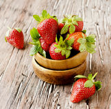 Fresh strawberries in a wooden bowl, selective focus Stock Image