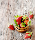 Fresh strawberries in a wooden bowl, selective focus Stock Photos