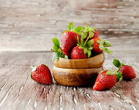 Fresh strawberries in a wooden bowl, selective focus Royalty Free Stock Image