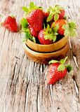 Fresh strawberries in a wooden bowl, selective focus Stock Photography