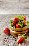 Fresh strawberries in a wooden bowl, selective focus Royalty Free Stock Photography
