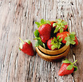 Fresh strawberries in a wooden bowl, selective focus Stock Images