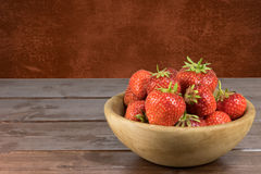 Fresh strawberries in the wooden bowl Royalty Free Stock Photo