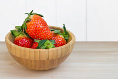 Fresh strawberries in wooden bowl Stock Photos