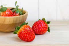 Fresh strawberries in wooden bowl Royalty Free Stock Photos