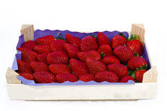 Fresh strawberries in a wooden crate Royalty Free Stock Photos