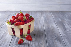 Fresh strawberries in a wooden crate Stock Photos