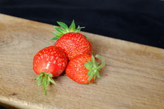 Fresh strawberries on a wooden cutting board Royalty Free Stock Images