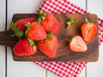 Fresh strawberries on a wooden cutting board stock image