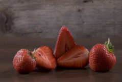Fresh strawberries on a wooden surface Stock Image
