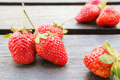 Fresh strawberries on wooden table Royalty Free Stock Images