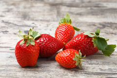 Fresh strawberries on a wooden table Stock Photography