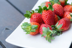 Fresh strawberries on a wooden table close-up Royalty Free Stock Image