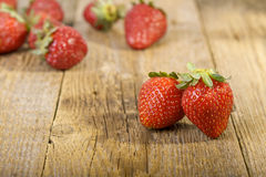 Fresh strawberries on wooden table Stock Photography