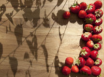 Fresh strawberries on wooden table Royalty Free Stock Photos