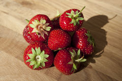 Fresh strawberries on wooden table Stock Image