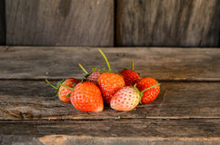 Fresh Strawberries on wooden table Stock Photos