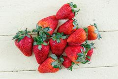 Fresh Strawberries on Yellow Background Royalty Free Stock Photography