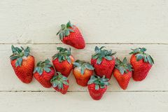 Fresh Strawberries on Yellow Background Royalty Free Stock Images