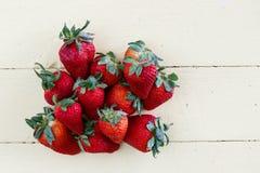 Fresh Strawberries on Yellow Background Royalty Free Stock Photos