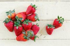 Fresh Strawberries on Yellow Background Stock Photo