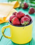 Fresh strawberries in a yellow cup Stock Photos