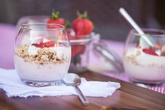 Fresh strawberries and yoghurt breakfast. Fresh strawberries with yoghurt at breakfast Royalty Free Stock Photography