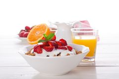 Fresh strawberries , yogurt and homemade granola. For healthy breakfast on white background, selective focus Royalty Free Stock Image
