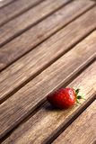Fresh Strawberry. A single red strawberry on a table stock photography