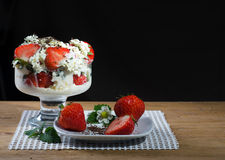 Fresh strawberry. Dessert with cream on a wood background Royalty Free Stock Photos
