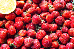 Fresh strawberry background. Ripe strawberry in close-up Stock Photos