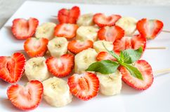 Fresh strawberry and banana skewers Stock Images